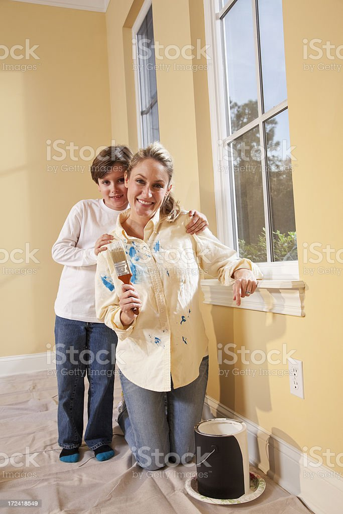 Mother and child painting home interior stock photo