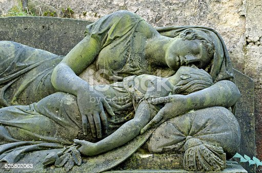 Mourning statue of Mother and child - old cemetery at Krasna Lipa, Czech republic, Europe