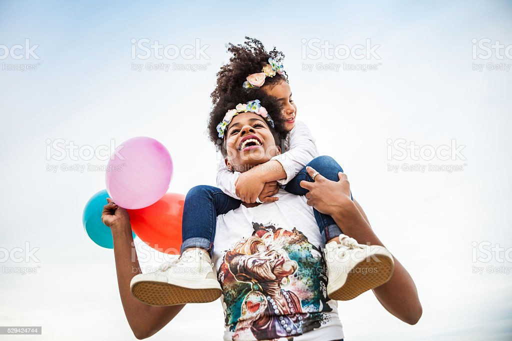 Mother and child play together celebrating stock photo