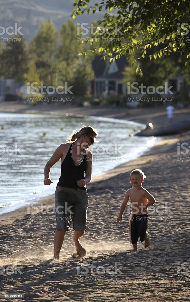 Mother and Child Playing on the Beach royalty-free stock photo