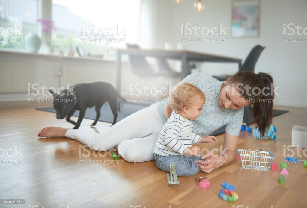 Mother and child playing on the floor stock photo