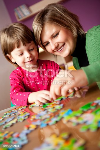 istock Mother and child playing with puzzle 182726504