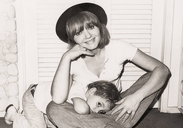mother and child posing in front of the camera - 1970s style stock photos and pictures