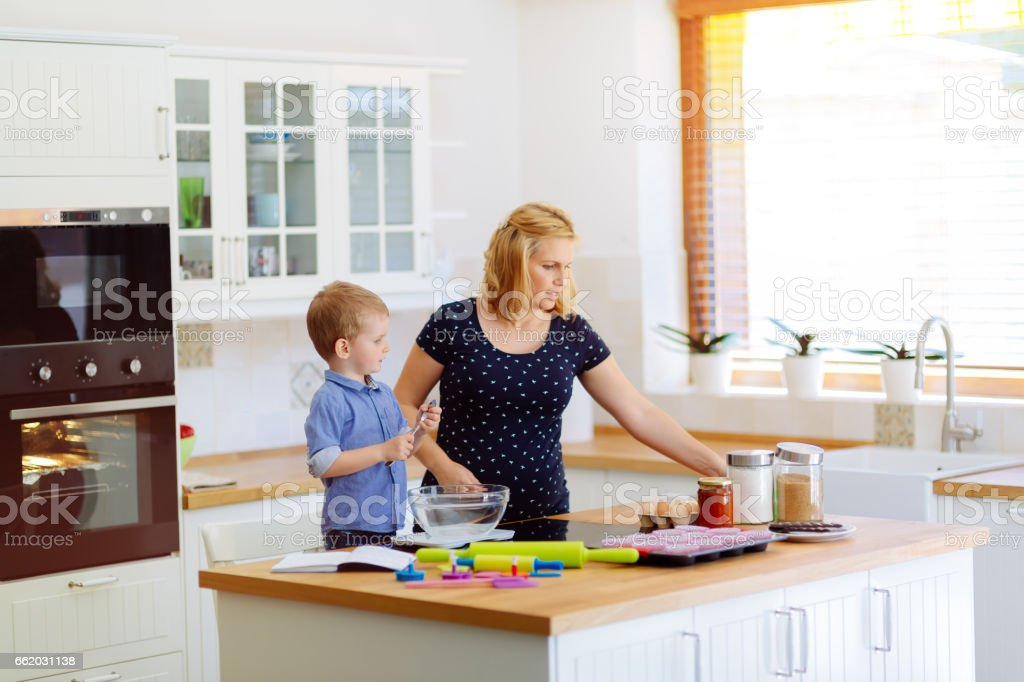 Mother and child preparing cookies in kitchen royalty-free stock photo