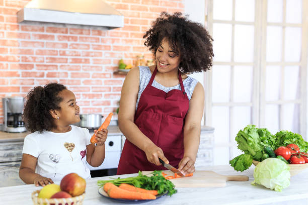 mother and child preparing healty meal - kids cooking stock photos and pictures