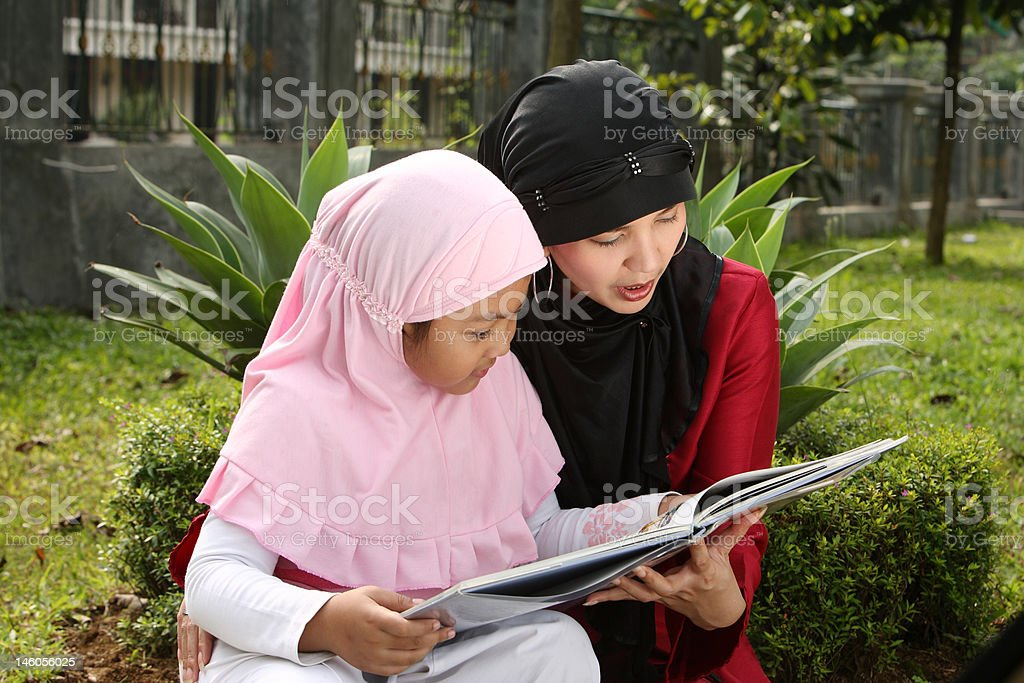 Mother and Child Reading a Book royalty-free stock photo