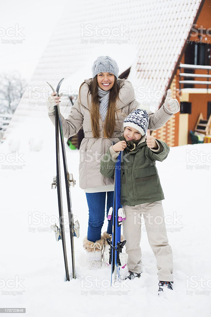 Mother and child ready for winter holiday royalty-free stock photo
