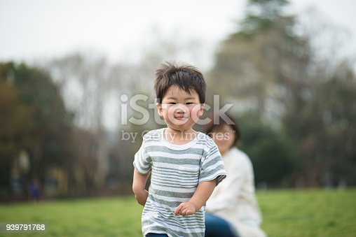 589135214 istock photo Mother and child relaxing and playing in park 939791768