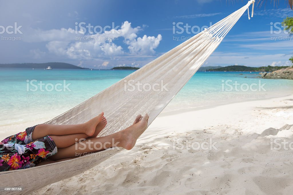 Caribbean Relaxation: Mother And Child Relaxing In Hammock At A Caribbean Beach