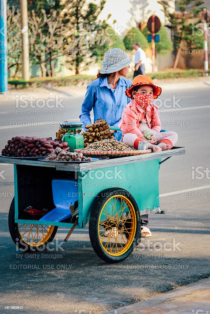 Mother and child street vendors stock photo