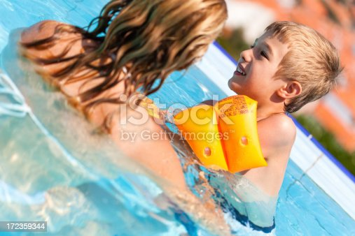 Mother And Child Swimming In Infinity Pool Stock Photo & More Pictures of 30-39 Years