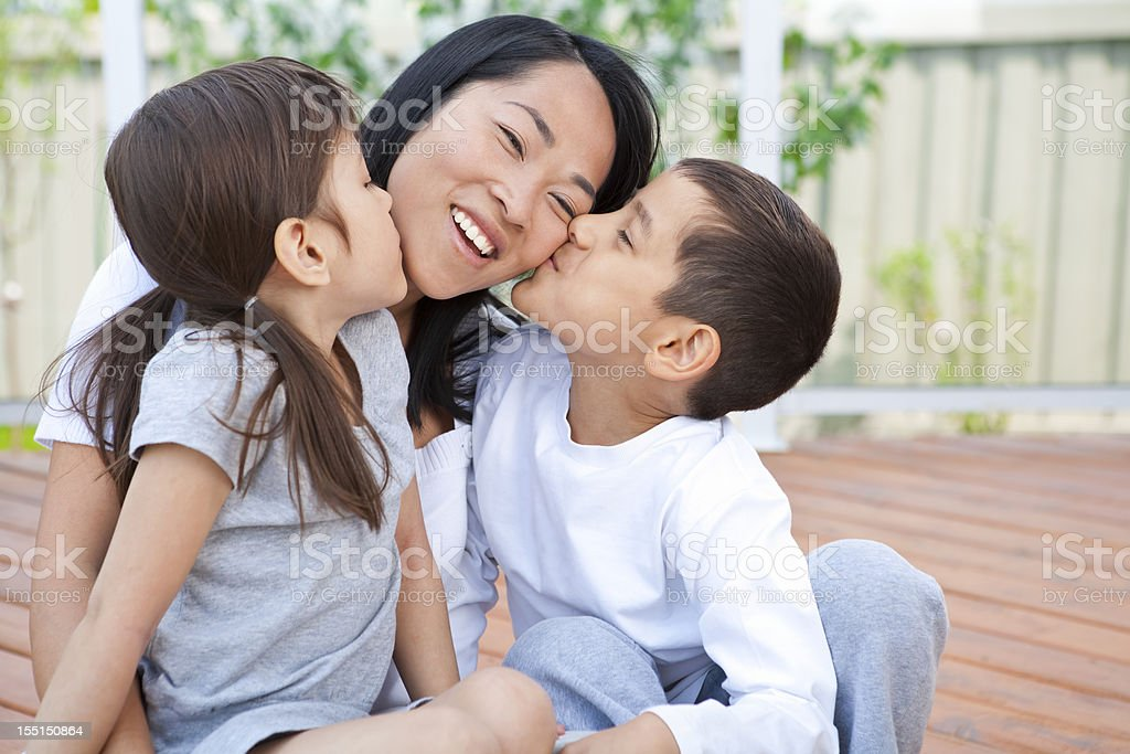 Mother and children being playful stock photo