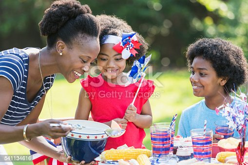 1091098220istockphoto Mother and children celebrating 4th of July 541134616