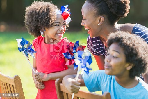 1091098220istockphoto Mother and children celebrating 4th of July 541836634