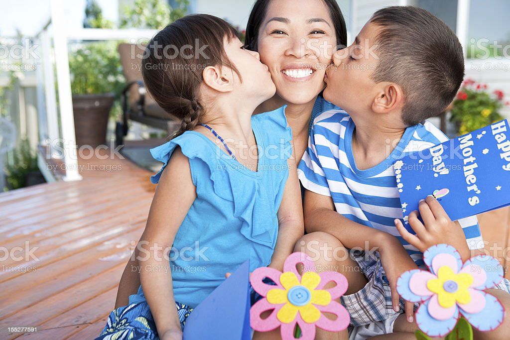 Mother and children celebrating Mother's Day stock photo