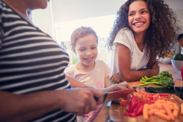Mother and children cooking in the kitchen. stock photo