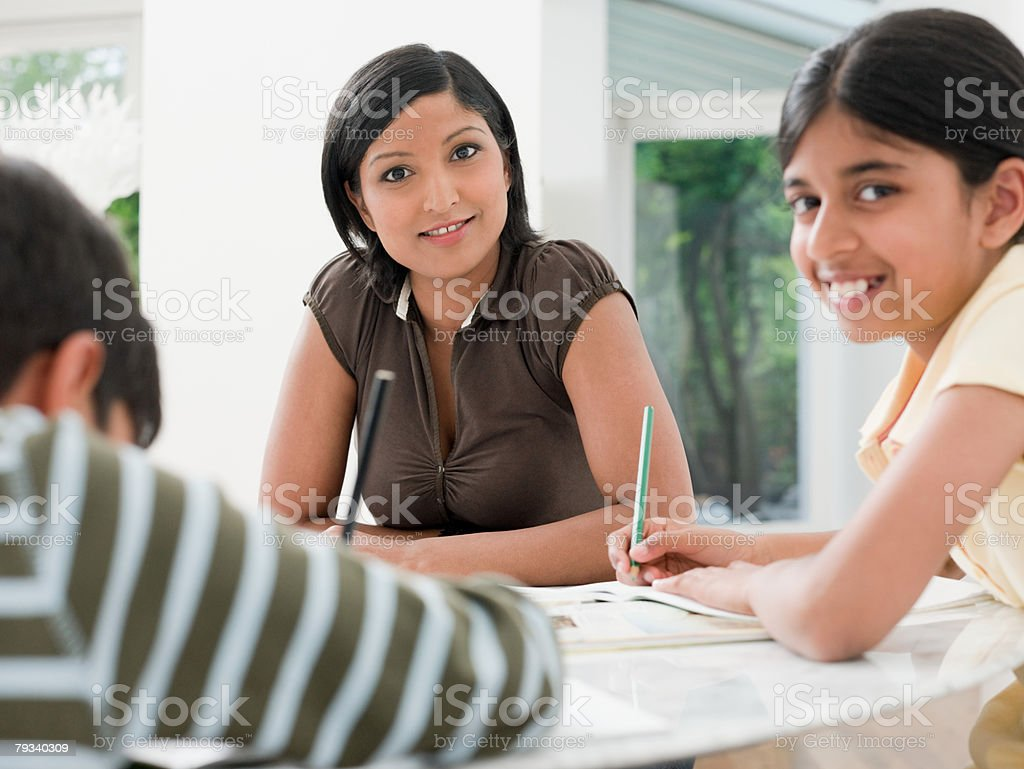 Mother and children doing homework royalty-free 스톡 사진
