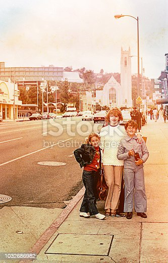 Vintage image of a mother and her children Posing in a street