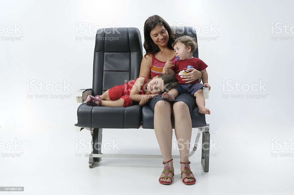 Mother and children on aircraft stock photo