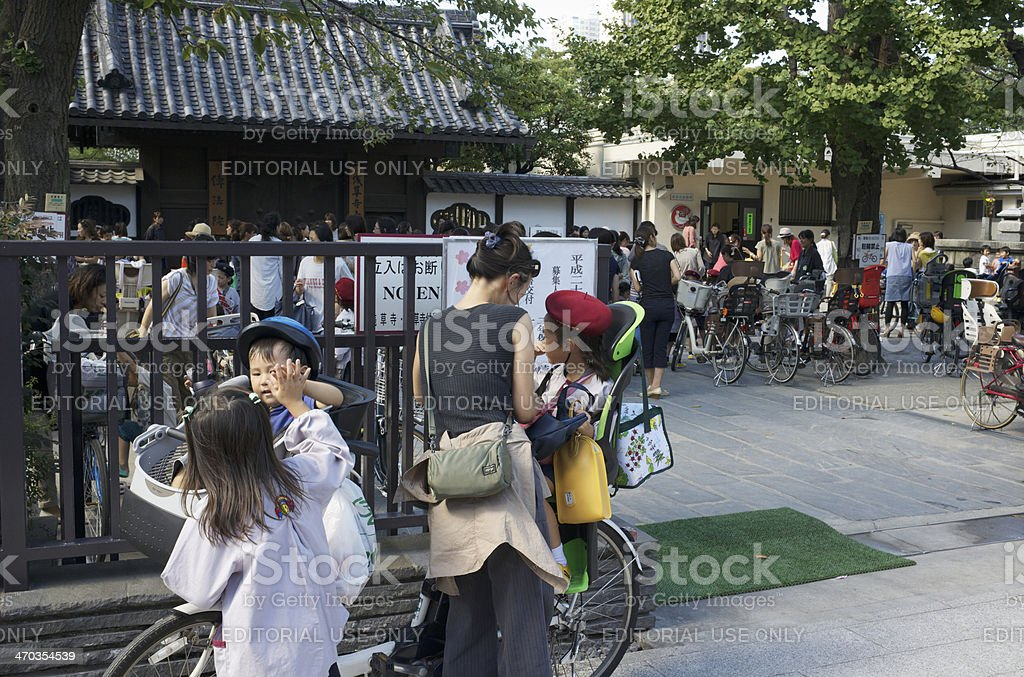 Mother and children outside kindergarten in Tokyo, Japan stock photo