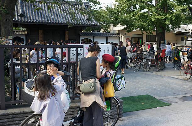 Mother and children outside kindergarten in Tokyo, Japan stock photo