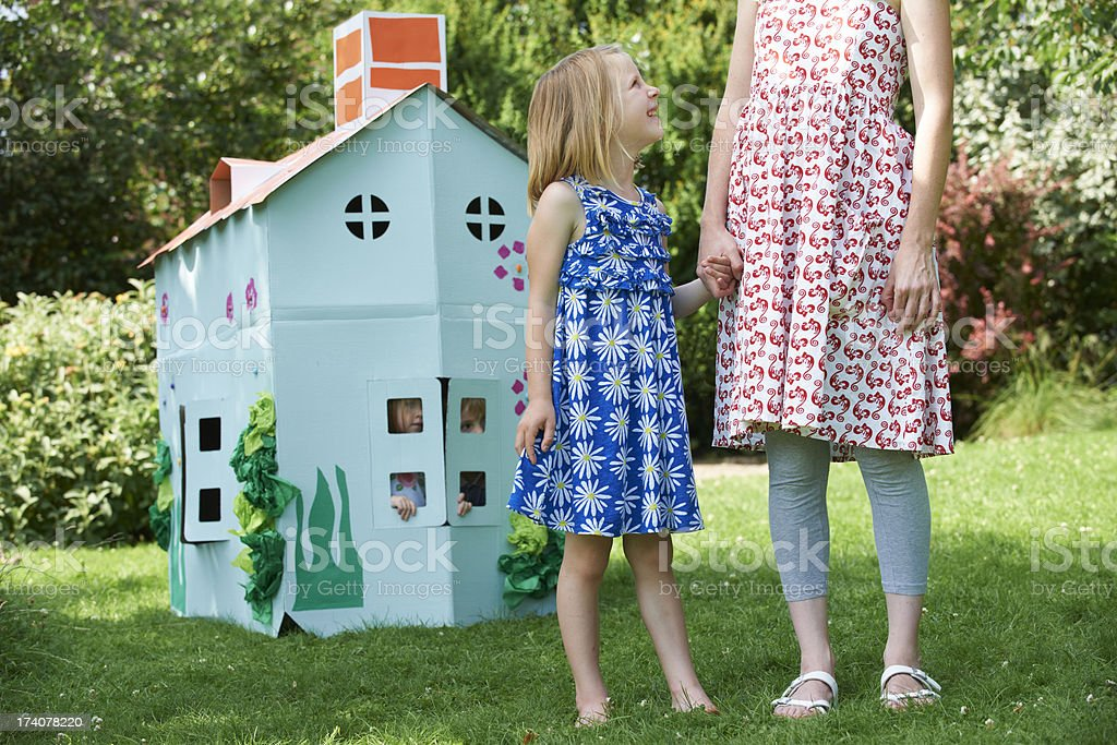Mother And Children Playing With Home Made Cardboard House stock photo