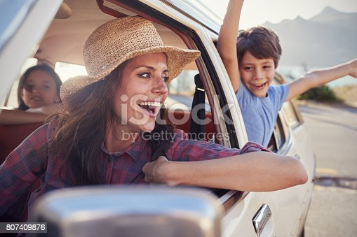 807410158 istock photo Mother And Children Relaxing In Car During Road Trip 807409876