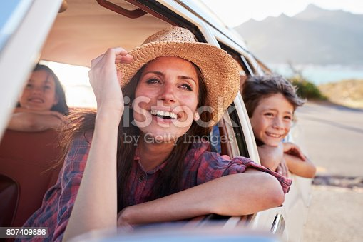 807410158 istock photo Mother And Children Relaxing In Car During Road Trip 807409886