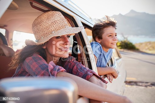 807410158 istock photo Mother And Children Relaxing In Car During Road Trip 807409940