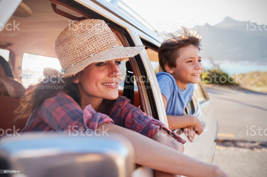 Mother And Children Relaxing In Car During Road Trip stock photo
