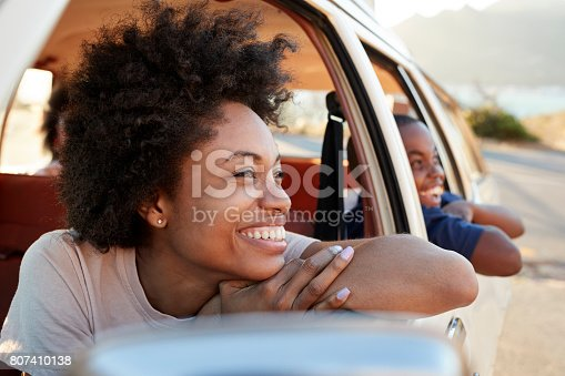 807410158 istock photo Mother And Children Relaxing In Car During Road Trip 807410138