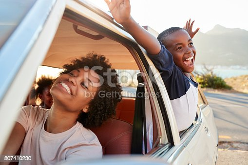 istock Mother And Children Relaxing In Car During Road Trip 807410230