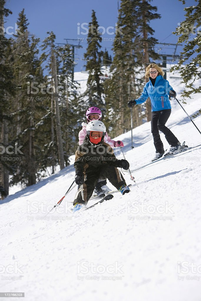 Mother and children skiing royalty-free stock photo