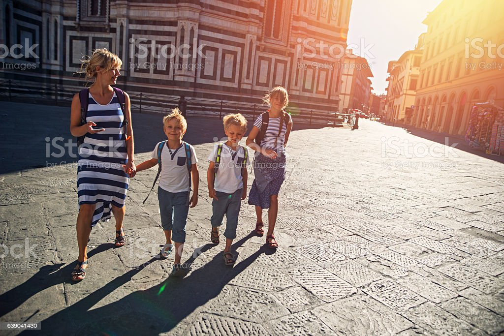 Mother and children tourist visiting Florence, Italy stock photo