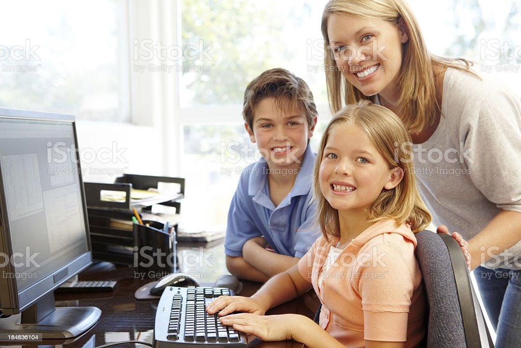 Mother and children using computer at home royalty-free stock photo