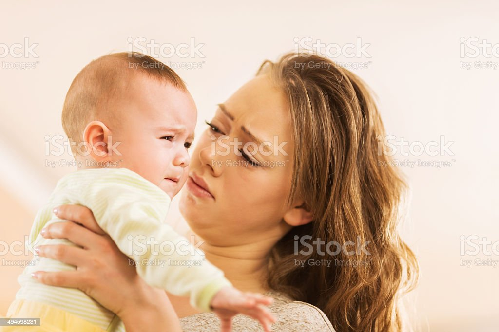 Mother and crying baby boy. stock photo