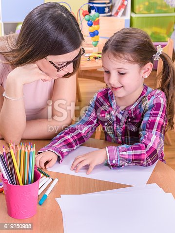 639271192 istock photo Mother and Cute Girl on Arst and Crafts Activities 619250988