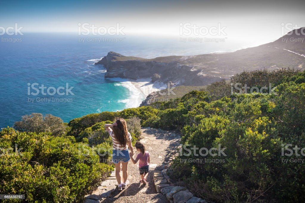 Mother and daugher at Cape Point enjoying the view stock photo