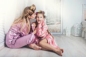 istock Mother and daughter alone at home beautiful, fashionable and fun 613308486