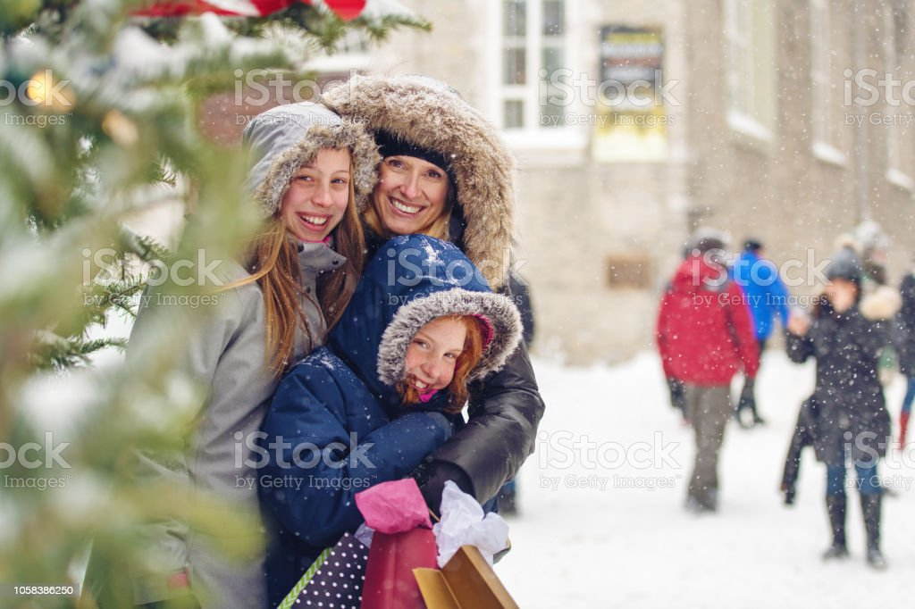 Mother and daughter and friend doing Christmas shopping stock photo