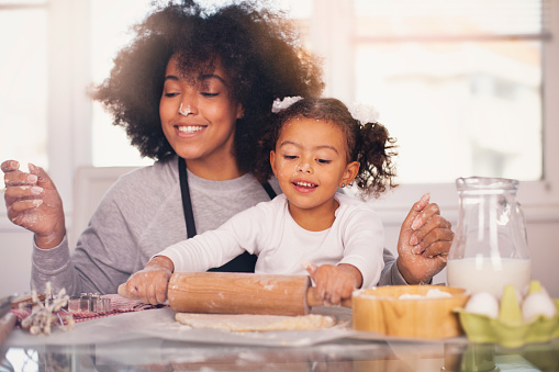 Mother and daughter are baking together