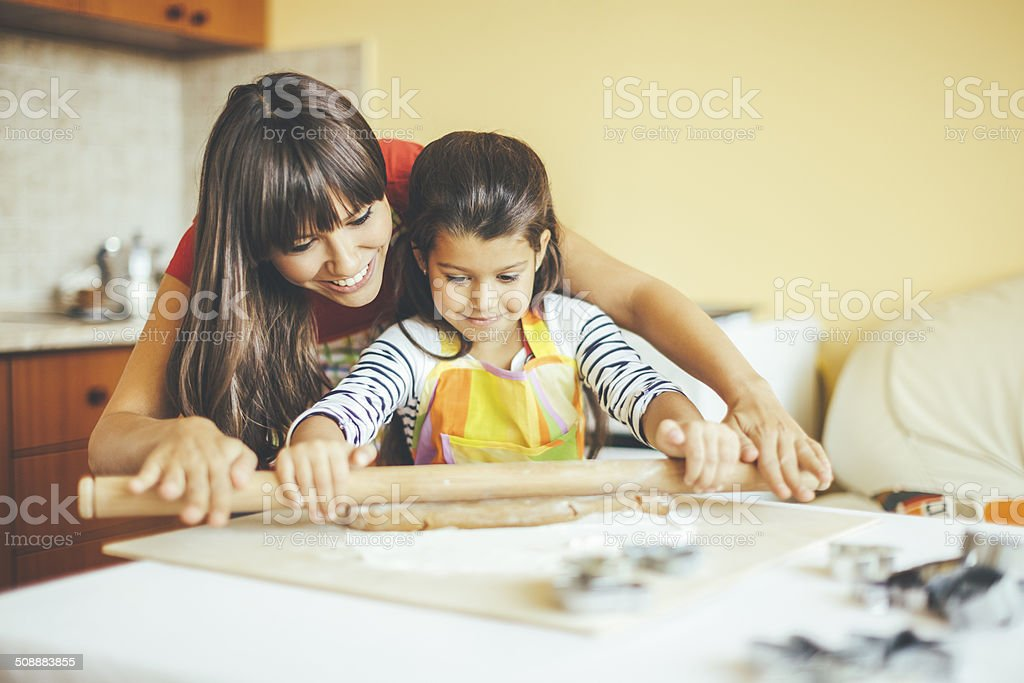 Mother and daughter are baking together stock photo