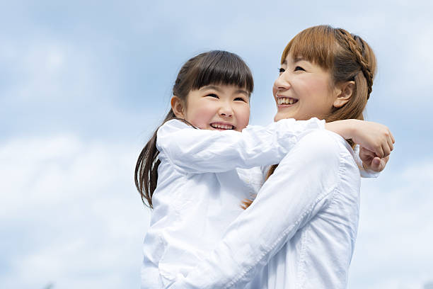 mother and daughter are both close - 母娘 笑顔 日本人 ストックフォトと画像