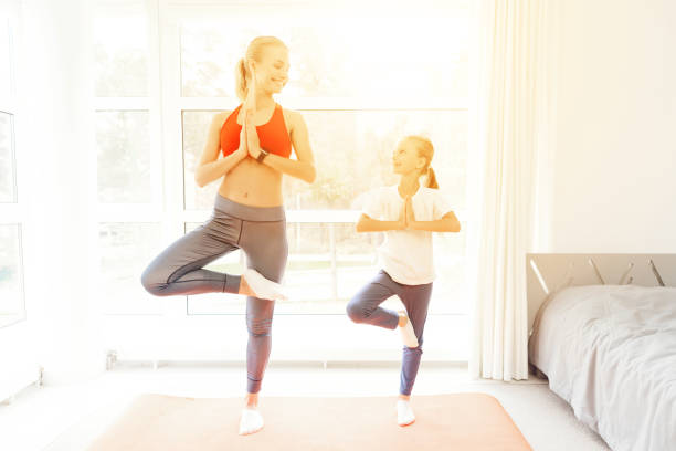 Mother and daughter are engaged in yoga in sportswear they are in a picture id912228554?b=1&k=6&m=912228554&s=612x612&w=0&h=cne6x ouxwkcldfszf4 tkhefdtubc wxetnftoopos=