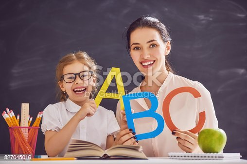 istock Mother and daughter are learning to write 827045016