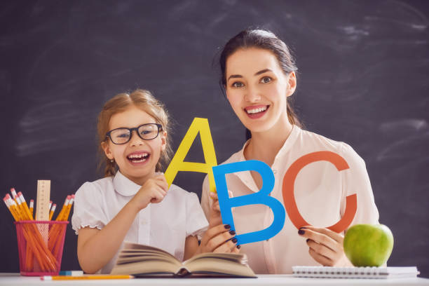 mother and daughter are learning to write - teachers day stock photos and pictures