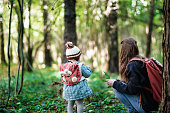istock Mother and daughter are looking into the forest 923035906