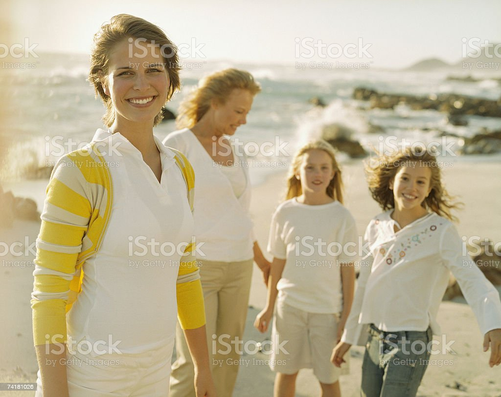Mother and daughter at beach with granddaughters royalty-free stock photo