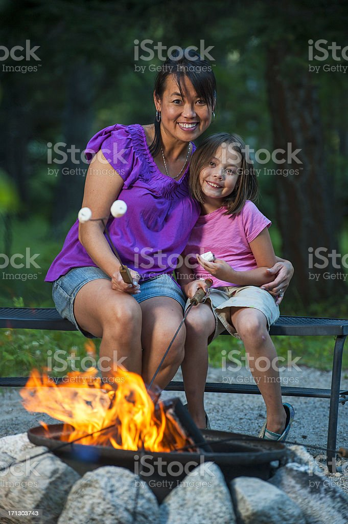 Mother and Daughter at Campfire royalty-free stock photo