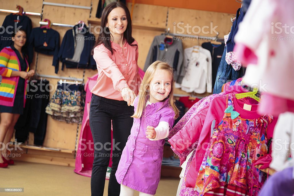 mother and daughter at children's store stock photo